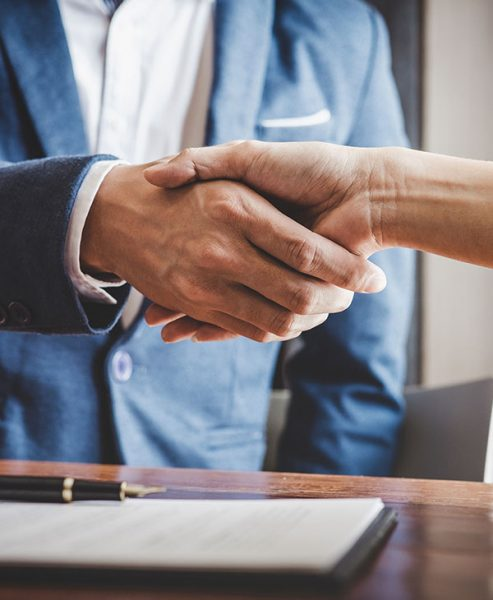 handshake with commercial mortgage lender and borrower